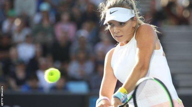 Katie Boulter returns a ball at the Australian Open in January