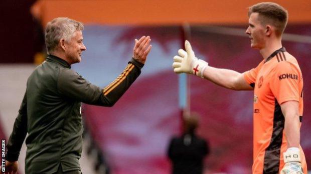 Ole Gunnar Solskjaer and goalkeeper Dean Henderson