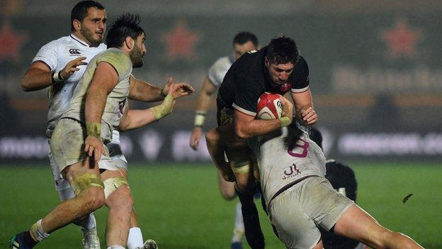 Justin Tipuric tackled as Beka Saghinadze (left) comes in with right arm