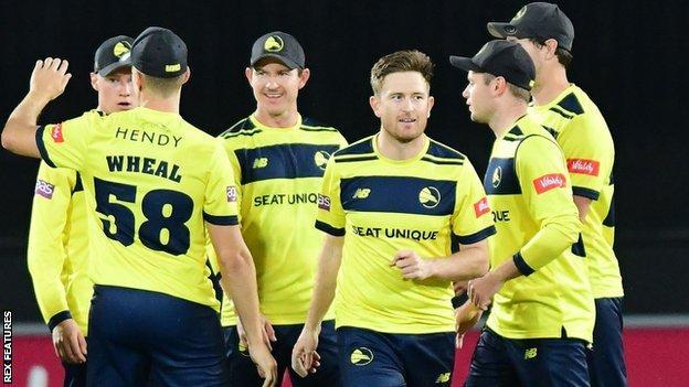 Liam Dawson takes a wicket for Hampshire