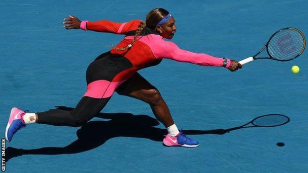 Serena Williams stretches for a shot