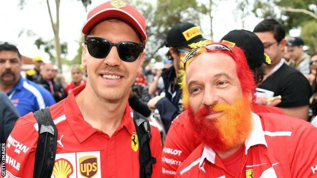 Sebastian Vettel and a fan with a multi-coloured beard