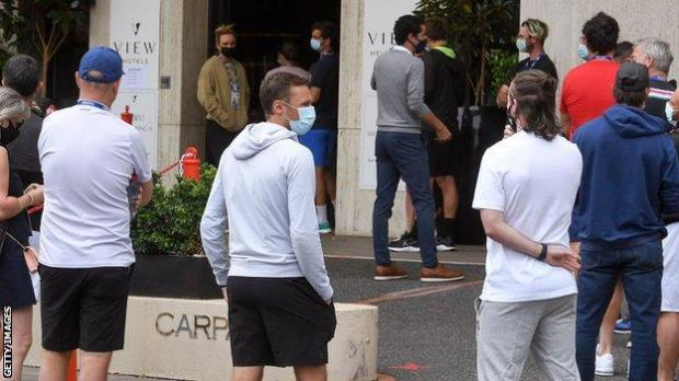 Players queue for a coronavirus test at a hotel in Melbourne