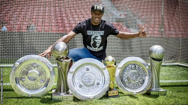 Anthony Nwakaeme with the trophies he won in Israel with Hapoel Be'er Sheva