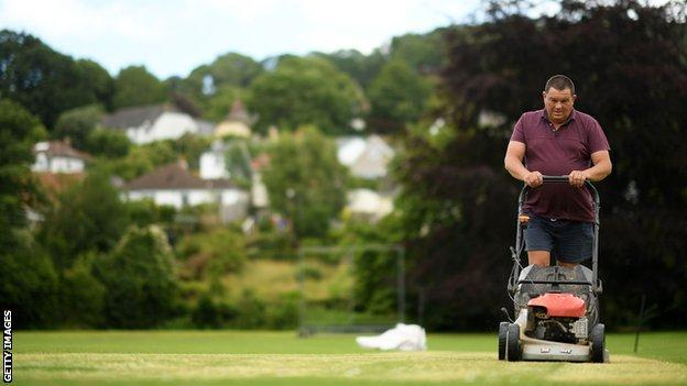 Groundsman at Uplyme and Lyme Regis cricket club prepares the square