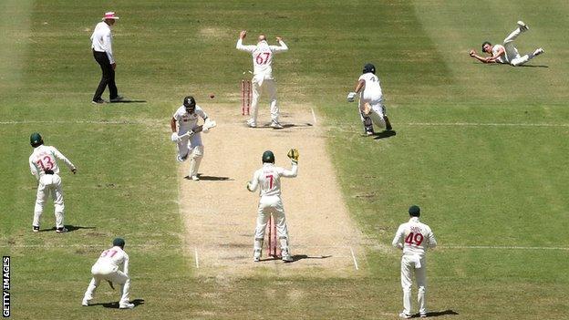 Australia bowler Josh Hazlewood (far right) runs out India batsman Hanuma Vihari on day three of the third Test