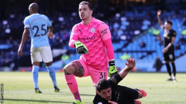 Manchester City keeper Ederson reacts during his side's Premier League game with West Ham