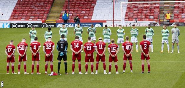 Aberdeen and Celtic players observe a minute's silence