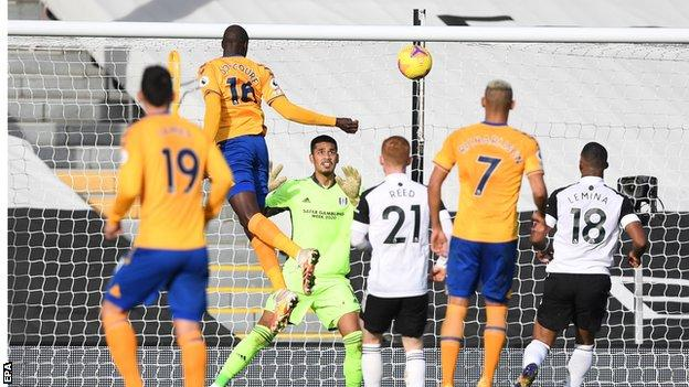 French midfielder Abdoulaye Doucoure rises unchallenged to head Everton's third goal against Fulham at Craven Cottage
