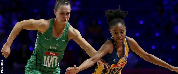 """Northern Ireland""""s Niamh Cooper challenges Damisha Croney of Barbados during Thursday's win"""