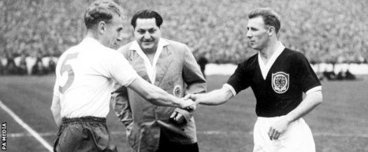 Tommy Docherty (right) captains Scotland against England