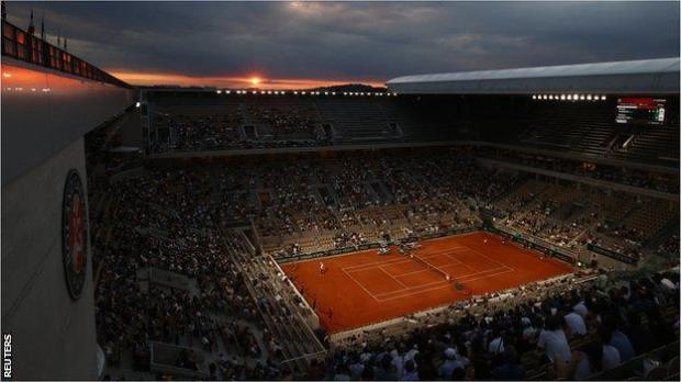 The sun sets over Court Philippe Chatrier as Novak Djokovic takes on Matteo Berrettini