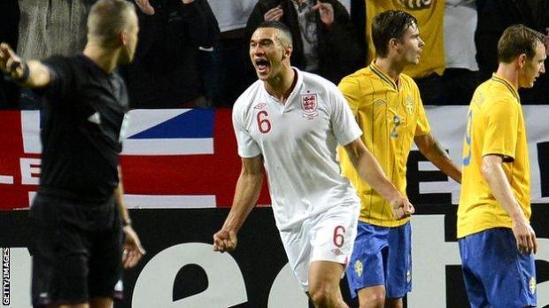 Steven Caulker celebrates his goal against Sweden on his England debut