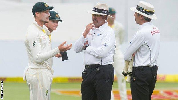Australia's Cameron Bancroft speaks to umpires Nigel Llong and Richard Illingworth