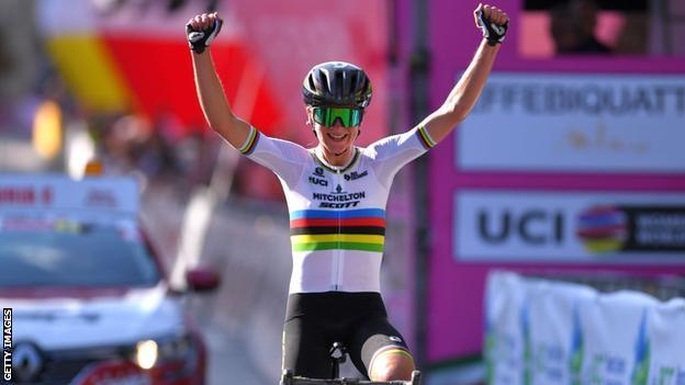 Annemiek van Vleuten celebrates as she crosses the finish line