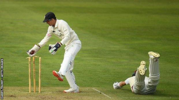 Somerset's Craig Overton survived this near run-out by Gareth Roderick in the derby game with Gloucestershire but his tail was up by the end of the day at Taunton with two wickets