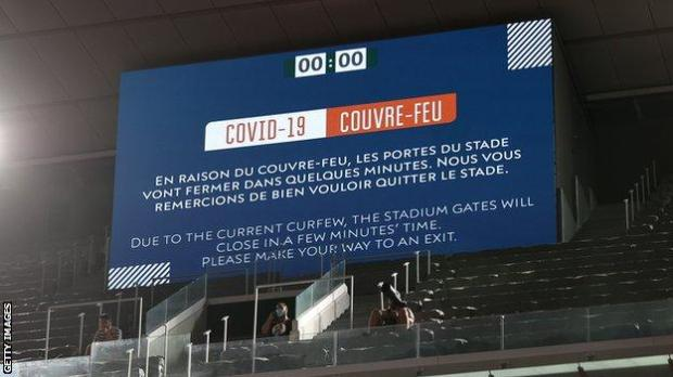 A message on the big screen informing fans they had to leave