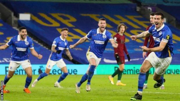 Lewis Dunk (right) celebrates scoring