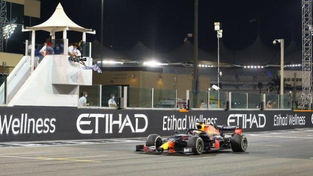Max Verstappen takes the chequered flag