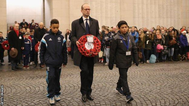 Jamal Musiala of Chelsea, Max von Olenhusen - the great great grandson of the German officer who called the Christmas day truce - and Seb Losa of Liverpool lay a wreath during the Menin Gate Ceremony on December 12, 2014 in Ypres, Belgium