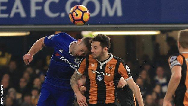 Ryan Mason and Gary Cahill challenging for the ball.