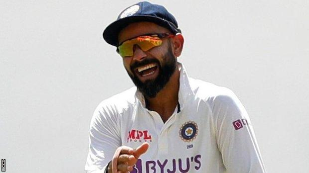 Virat Kohli celebrates a wicket against England