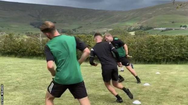 Northwich Victoria players training in the garden of manager Steve Wilkes' house