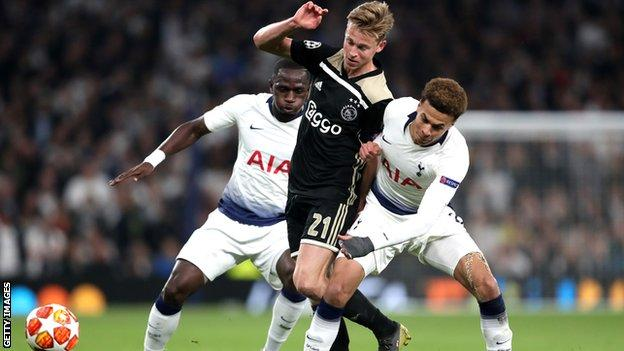 Ajax midfielder Frenkie de Jong holds off a challenge from Tottenham's Dele Alli