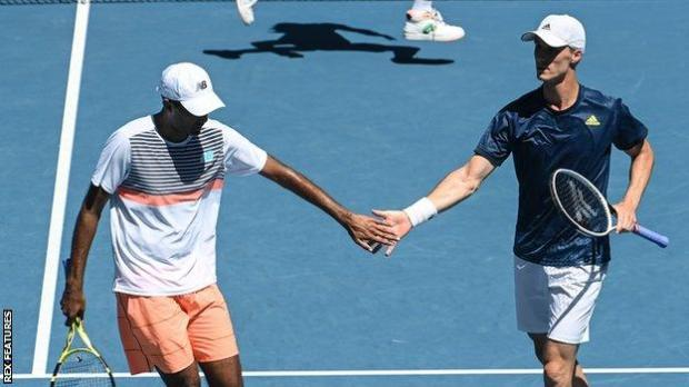 Rajeev Ram and Joe Salisbury celebrate winning a point in the Australian Open men's doubles semi-finals