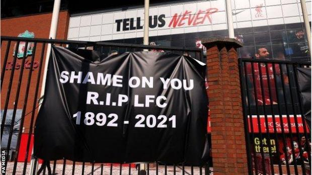 Liverpool banner saying 'shame on you, RIP LFC'