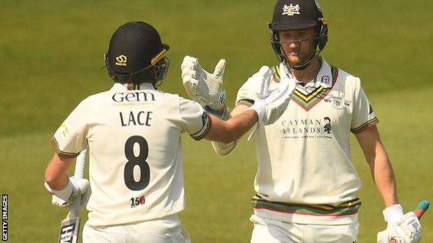 Tom Lace and James Bracey celebrate Gloucestershire's win against Somerset
