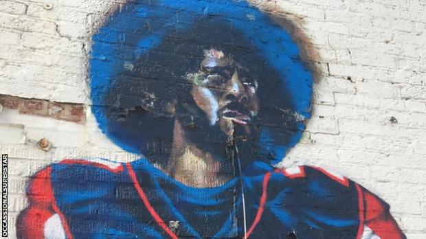 The mural, on an abandoned building in 2017, showed Kaepernick in an Atlanta Falcons uniform