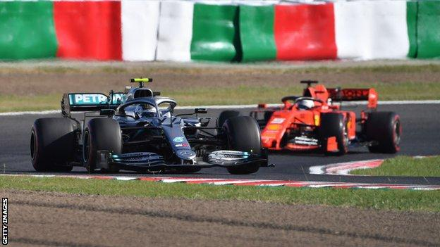 Sebastian Vettel and Valtteri Bottas racing at the Japanese Grand Prix