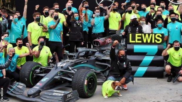Lewis Hamilton celebrates with the Mercedes team