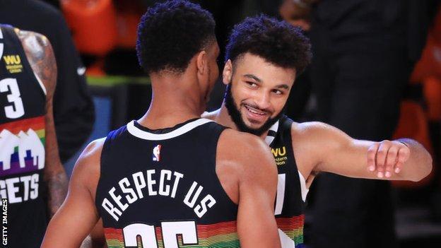 Denver Nuggets Jamal Murray and PJ Dozier embrace