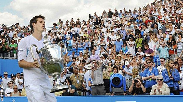 sport Andy Murray carries the Queen's trophy after winning his first title at the west London club in 2009