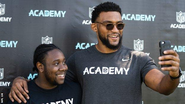 Christian Scotland-Williamson with a student at the NFL Academy