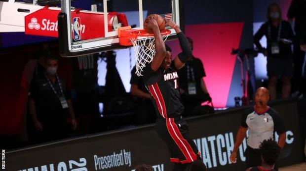Bam Adebayo scores a dunk for the Miami Heat