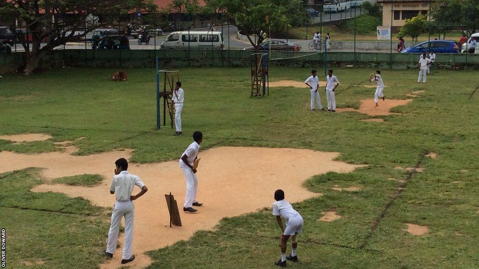 Children playing cricket in Galle