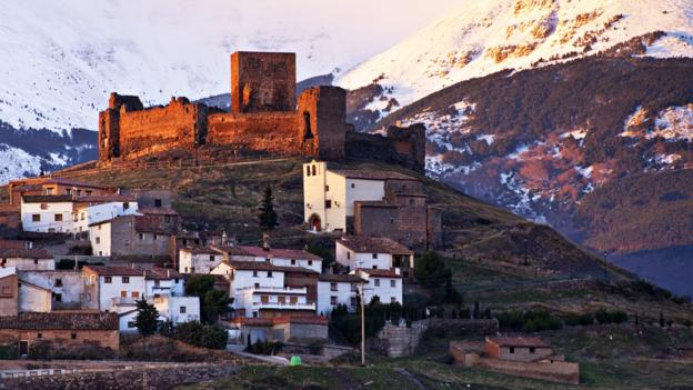 The half-ruined 12th-century Trasmoz Castle is perched on a hilltop above the village (Credit: Credit: Julio Alvarez German/Getty)