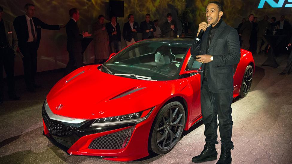 With the NSX at the 2016 Detroit auto show. (Credit: American Honda Motor)