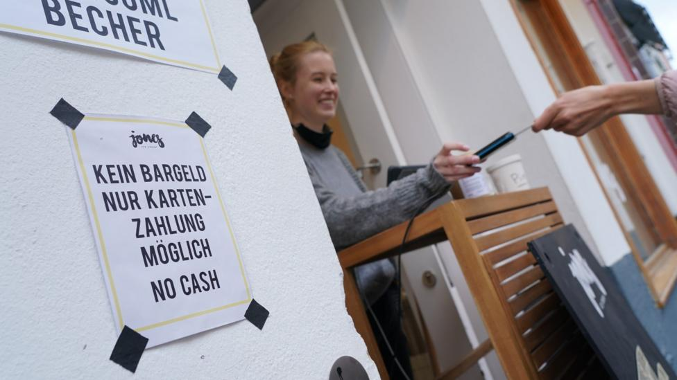 For the first time, some shops and businesses are actively discouraging cash payments