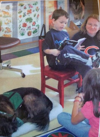 Reading to a therapy dog at the library
