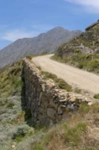 Südafrika South Africa Kleine Karoo Oudtshoorn Swartberge Swartberg Pass Berge Schotterstraße