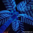 Outside blue LED lighted artificial palm tree
