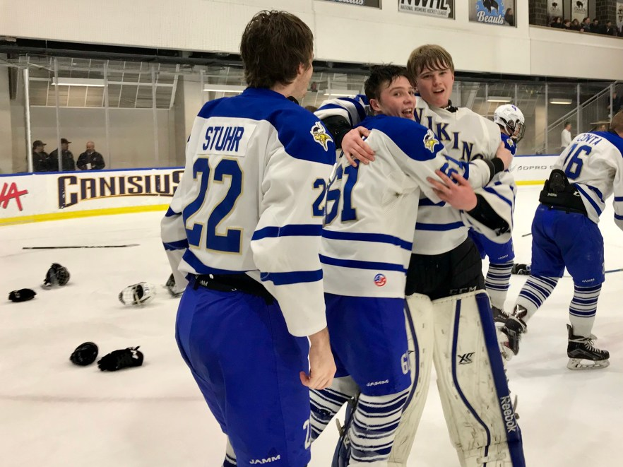 82b6b00a34a Stroh celebrates with teammates Brian O Neill (61) and Mike Stuhr (22)  after Grand Island s first Section VI Championship in school history.