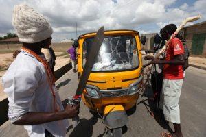 Civilian JTF man checkpoints in Maiduguri~(AP Photo)