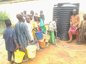 Almajiri pupils queuing for water in Sokotoe school
