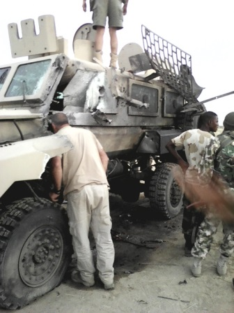 The damaged APC in which two South African mercenaries died