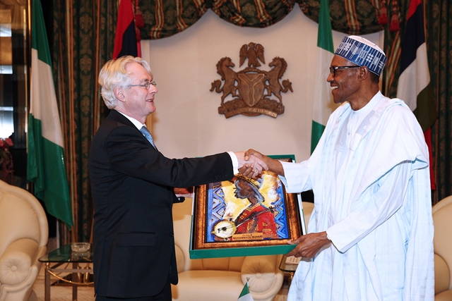 President Buhari presents the outgoing Ambassador with a gift